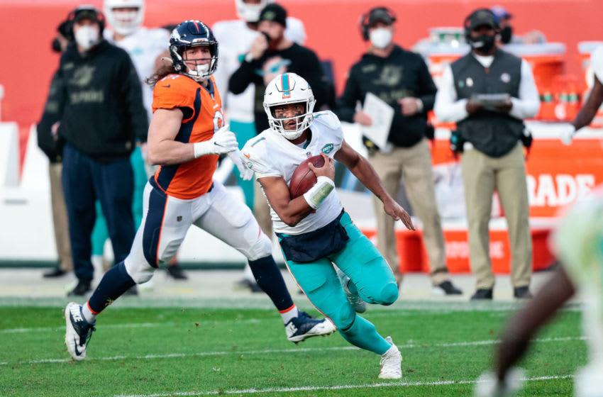 Nov 22, 2020; Denver, Colorado, USA; Miami Dolphins quarterback Tua Tagovailoa (1) runs the ball in the third quarter against the Denver Broncos at Empower Field at Mile High. Mandatory Credit: Isaiah J. Downing-USA TODAY Sports