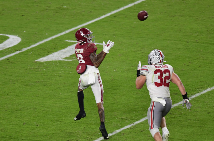 Jan 11, 2021; Miami Gardens, FL, USA; Alabama Crimson Tide wide receiver DeVonta Smith (6) scores a touchdown past Ohio State Buckeyes linebacker Tuf Borland (32) in the second quarter in the 2021 College Football Playoff National Championship Game at Hard Rock Stadium. Mandatory Credit: Douglas DeFelice-USA TODAY Sports