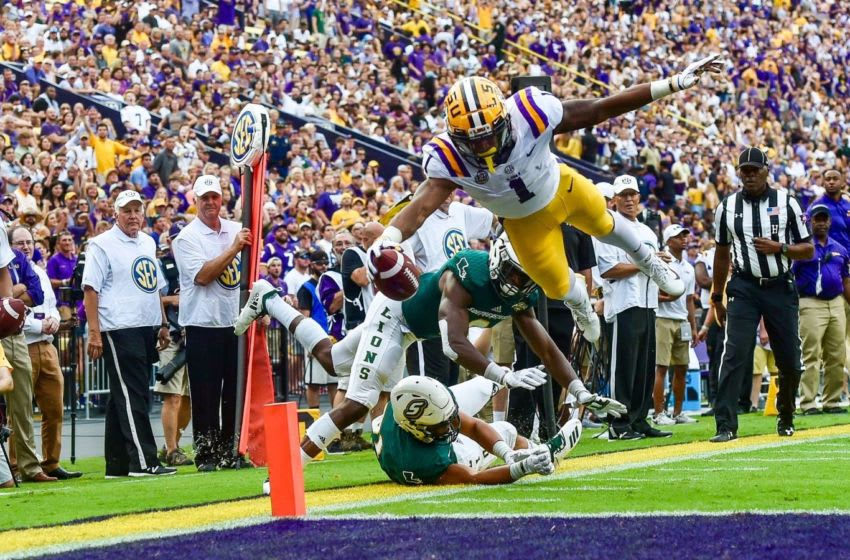 LSU wide receiver Ja'Marr Chase catches a 9-yard touchdown pass from quarterback Joe Burrow to give Tigers a 7-0 lead over Southeastern Louisiana in the first quarter Saturday night at Tiger Stadium. Lsu Southeastern LSU wide receiver JaaTMMarr Chase catches a 9-yard touchdown pass from quarterback Joe Burrow to give Tigers a 7-0 lead over Southeastern Louisiana in the first quarter Saturday night at Tiger Stadium.