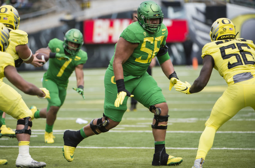 Apr 20, 2019; Eugene, OR, USA; Oregon Ducks offensive lineman Penei Sewell (58) blocks a defender during the Oregon spring game at Autzen Stadium. Mighty Oregon beat Fighting Ducks 20-13. Mandatory Credit: Troy Wayrynen-USA TODAY Sports