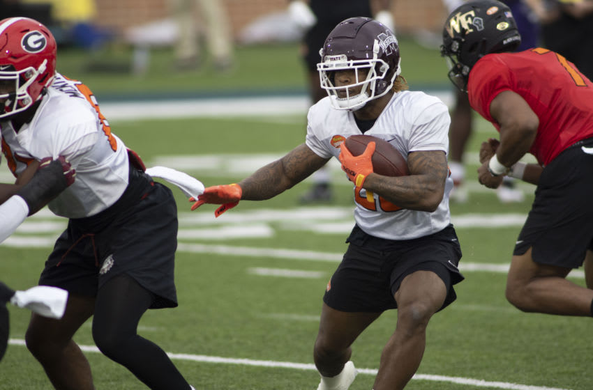 Jan 26, 2021; Mobile, Alabama, USA; American running back Kylin Hill of Mississippi State (20) runs the ball during National team practice during the 2021 Senior Bowl week. Mandatory Credit: Vasha Hunt-USA TODAY Sports