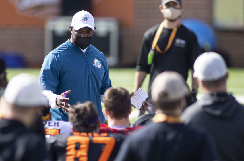 Jan 27, 2021; Mobile, AL, USA; National head coach Brian Flores of the Miami Dolphins talks with his squad after National practice at Hancock Whitney Stadium. Mandatory Credit: Vasha Hunt-USA TODAY Sports
