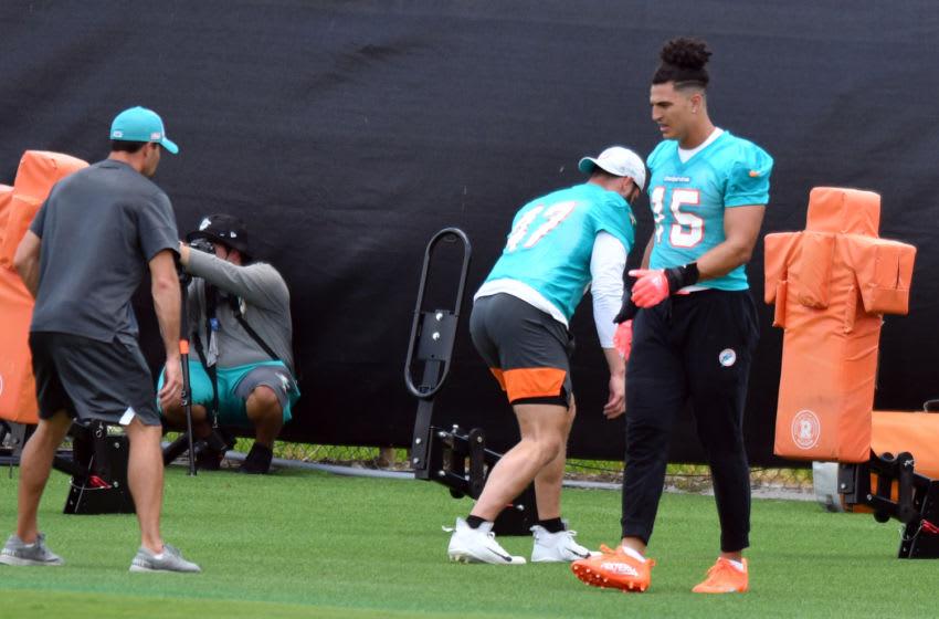May 26, 2021; Davie, Florida, USA; Miami Dolphins linebacker Jaelan Phillips (15) participates in OTA workouts at Baptist Health Training Facility. Mandatory Credit: Jim Rassol-USA TODAY Sports