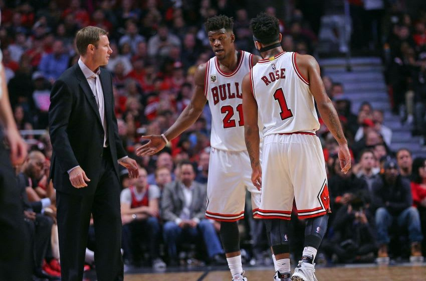 Oct 27, 2015; Chicago, IL, USA; Chicago Bulls head coach Fred Hoiberg talks with guard Jimmy Butler (21) and guard Derrick Rose (1) during the second half against the Cleveland Cavaliers at the United Center. Chicago won 97-95. Mandatory Credit: Dennis Wierzbicki-USA TODAY Sports