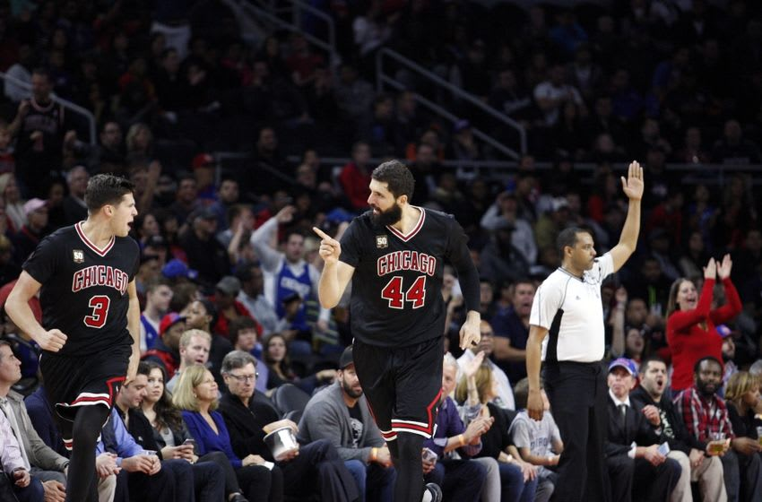 Oct 30, 2015; Auburn Hills, MI, USA; Chicago Bulls forward Nikola Mirotic (44) points at forward Doug McDermott (3) after making a basket during the fourth quarter against the Detroit Pistons at The Palace of Auburn Hills. Pistons win in overtime 98-94. Mandatory Credit: Raj Mehta-USA TODAY Sports