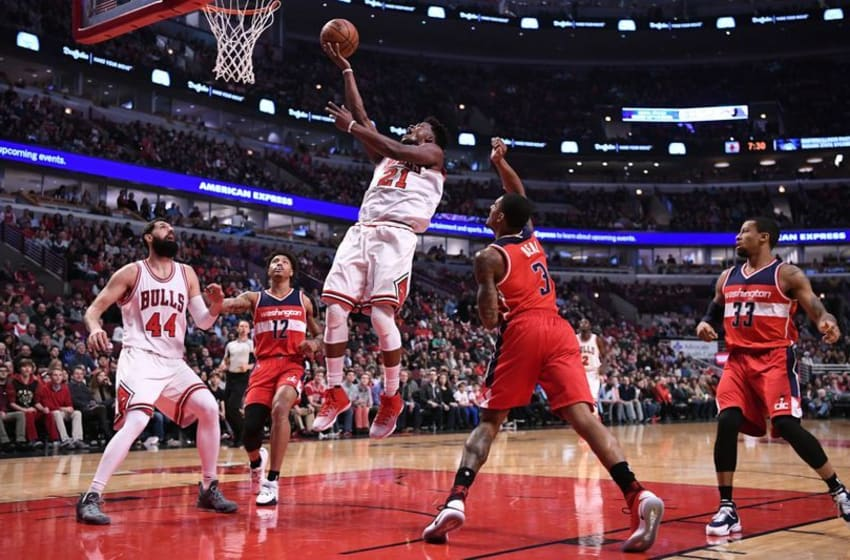 Dec 21, 2016; Chicago, IL, USA; Chicago Bulls forward Jimmy Butler (21) shoots the ball against Washington Wizards guard Bradley Beal (3) during the first half at the United Center. Mandatory Credit: Mike DiNovo-USA TODAY Sports