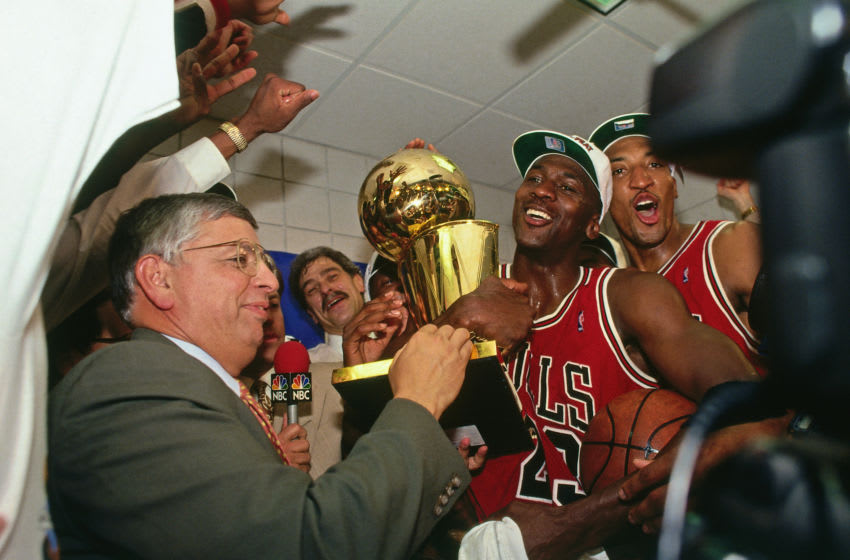PHOENIX - JUNE 20: NBA Commissioner David Stern presents Michael Jordan and the Chicago Bulls the championship trophy after the Bulls defeated the Phoenix Suns in Game Six of the 1993 NBA Finals on June 20, 1993 at America West Arena in Phoenix, Arizona. NOTE TO USER: User expressly acknowledges and agrees that, by downloading and or using this photograph, User is consenting to the terms and conditions of the Getty Images License Agreement. Mandatory Copyright Notice: Copyright 1993 NBAE (Photo by Andrew D. Bernstein/NBAE via Getty Images)