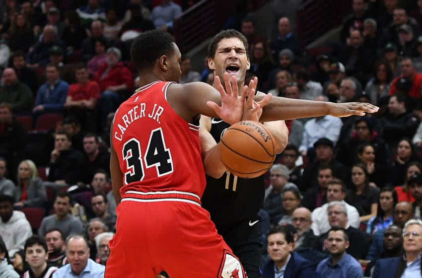 CHICAGO, ILLINOIS - NOVEMBER 18: Brook Lopez #11 of the Milwaukee Bucks is fouled by Wendell Carter Jr. #34 of the Chicago Bulls during the second half of a game at United Center on November 18, 2019 in Chicago, Illinois. NOTE TO USER: User expressly acknowledges and agrees that, by downloading and or using this photograph, User is consenting to the terms and conditions of the Getty Images License Agreement. (Photo by Stacy Revere/Getty Images)