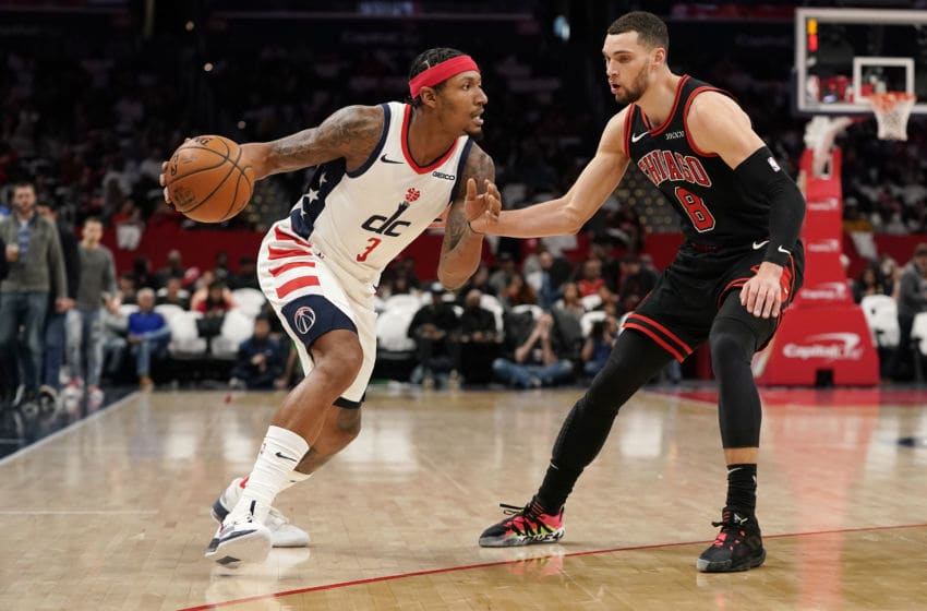 WASHINGTON, DC - DECEMBER 18: Bradley Beal #3 of the Washington Wizards dribbles the ball against Zach LaVine #8 of the Chicago Bulls in the second half at Capital One Arena on December 18, 2019 in Washington, DC. NOTE TO USER: User expressly acknowledges and agrees that, by downloading and or using this photograph, User is consenting to the terms and conditions of the Getty Images License Agreement. (Photo by Patrick McDermott/Getty Images)