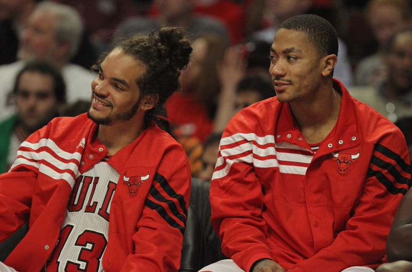 CHICAGO, IL - MARCH 05: Joakim Noah #13 (L) and Derrick Rose #1 of the Chicago Bulls enjoy watching teammates take on the Indiana Pacers at the United Center on March 5, 2012 in Chicago, Illinois. The Bulls defeated the Pacers 92-72. NOTE TO USER: User expressly acknowledges and agrees that, by downloading and or using this photograph, User is consenting to the terms and conditions of the Getty Images License Agreement. (Photo by Jonathan Daniel/Getty Images)