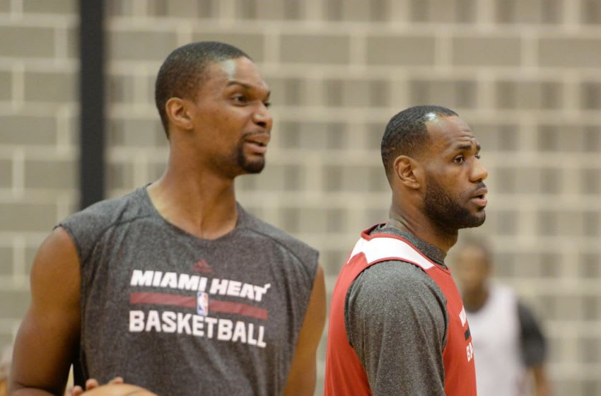 LeBron James, Chris Bosh (Photo credit should read ROBYN BECK/AFP via Getty Images)