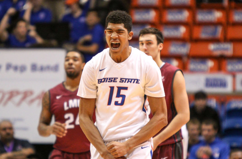BOISE, ID - DECEMBER 9: Guard Chandler Hutchison #15 of the Boise State Broncos celebrates a critical turnover during second half action against the Loyola Marymount Lions on December 9, 2015 at Taco Bell Arena in Boise, Idaho. Boise State won the game 67-66. (Photo by Loren Orr/Getty Images)