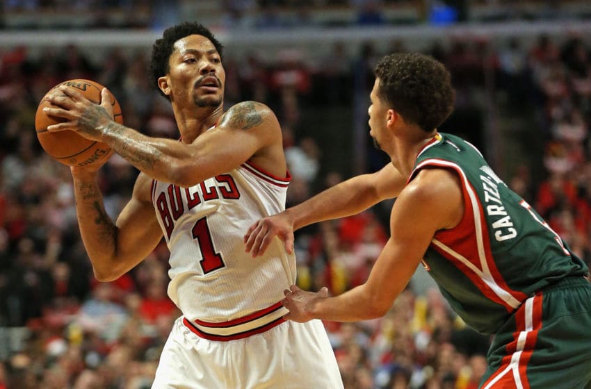 CHICAGO, IL - APRIL 20: Derrick Rose #1 of the Chicago Bulls looks to pass over Michael Carter-Williams #5 of the Milwaukee Bucks during the first round of the 2015 NBA Playoffs at the United Center on April 20, 2015 in Chicago, Illinois. The Bulls defeated the Bucks 91-82. NOTE TO USER: User expressly acknowledges and agress that, by downloading and or using the photograph, User is consenting to the terms and conditions of the Getty Images License Agreement. (Photo by Jonathan Daniel/Getty Images)