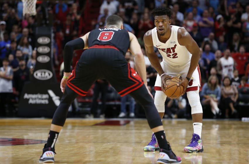 MIAMI, FLORIDA - DECEMBER 08: Jimmy Butler #22 of the Miami Heat in action against Zach LaVine #8 of the Chicago Bulls during overtime at American Airlines Arena on December 08, 2019 in Miami, Florida. NOTE TO USER: User expressly acknowledges and agrees that, by downloading and/or using this photograph, user is consenting to the terms and conditions of the Getty Images License Agreement. (Photo by Michael Reaves/Getty Images)