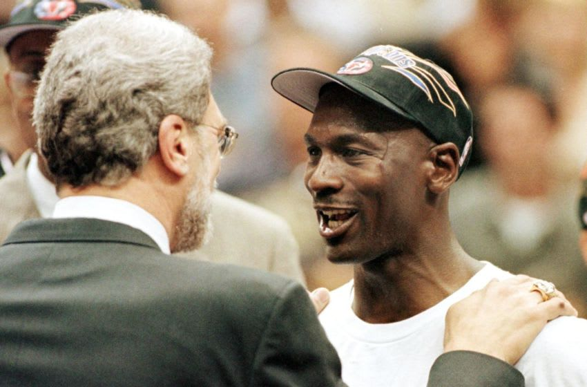 SALT LAKE CITY, UNITED STATES: Michael Jordan (R) and Chicago Bulls head coach Phil Jackson (L) congratulate each other 14 June after winning game six of the NBA Finals against the Utah Jazz at the Delta Center in Salt Lake City, UT. The Bulls won the game 87-86 to win their sixth NBA championship. AFP PHOTO/Jeff HAYNES (Photo credit should read JEFF HAYNES/AFP via Getty Images)
