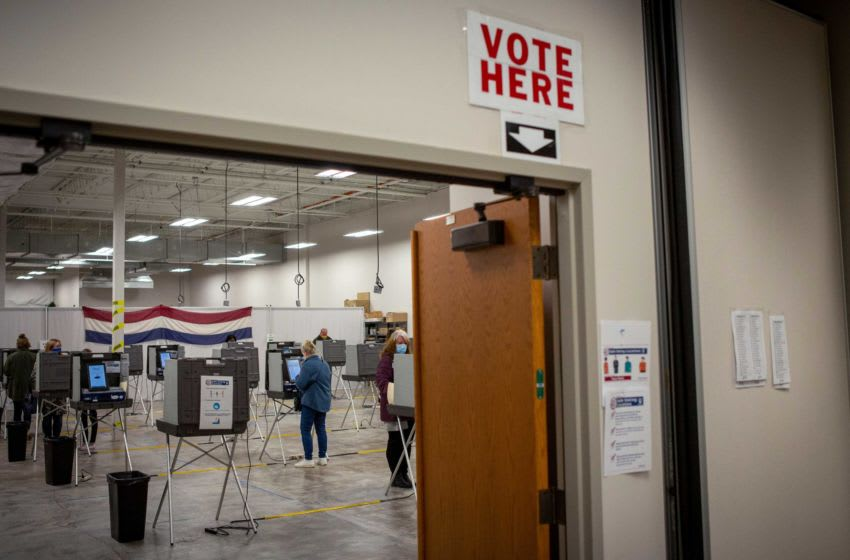 Voters in Delaware County cast their ballot during early voting at the Board of Elections on the north side of Delaware, Ohio on Tuesday, Oct. 27, 2020. Delaware County Voters Cast Early Election Ballots