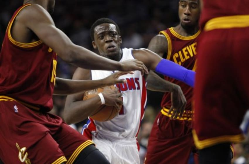 Feb 24, 2015; Auburn Hills, MI, USA; Detroit Pistons guard Reggie Jackson (1) dribbles through Cleveland Cavaliers defenders during the third quarter at The Palace of Auburn Hills. The Cavaliers beat the Pistons 102-93. Mandatory Credit: Raj Mehta-USA TODAY Sports