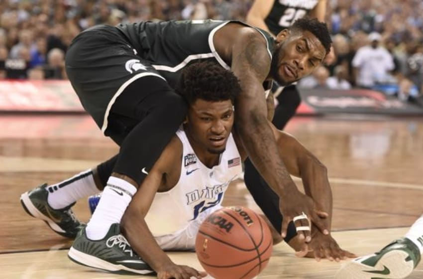 Apr 4, 2015; Indianapolis, IN, USA; Duke Blue Devils forward Justise Winslow (12) battles for a loos ball with Michigan State Spartans guard/forward Branden Dawson (22) in the second half of the 2015 NCAA Men
