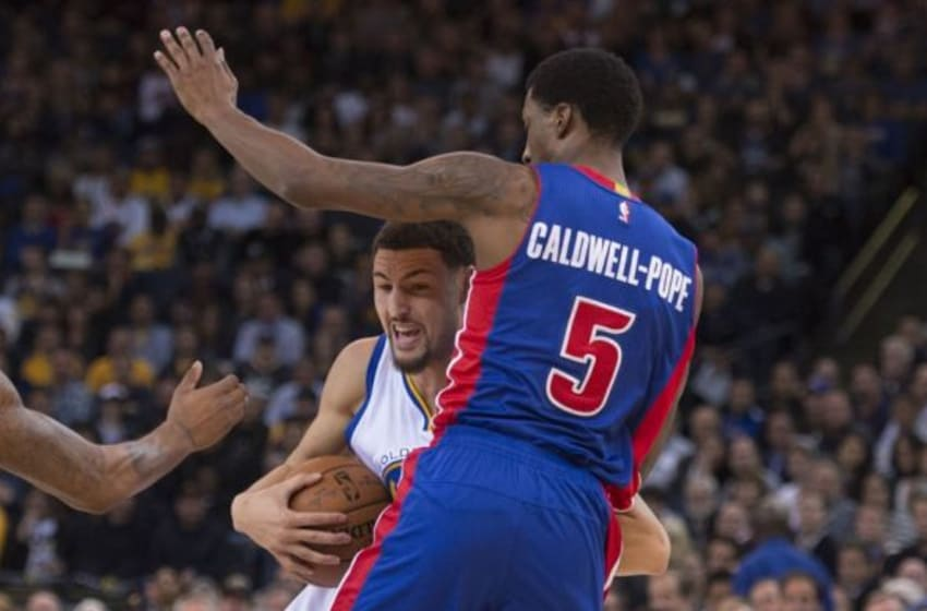 November 9, 2015; Oakland, CA, USA; Golden State Warriors guard Klay Thompson (11, left) drives to the basket against Detroit Pistons guard Kentavious Caldwell-Pope (5) during the first quarter at Oracle Arena. Mandatory Credit: Kyle Terada-USA TODAY Sports