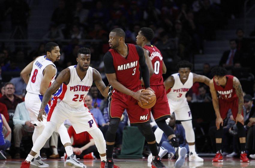Apr 12, 2016; Auburn Hills, MI, USA; Miami Heat guard Dwyane Wade (3) is defended by Detroit Pistons forward Reggie Bullock (25) during the fourth quarter at The Palace of Auburn Hills. Heat win 99-93. Mandatory Credit: Raj Mehta-USA TODAY Sports