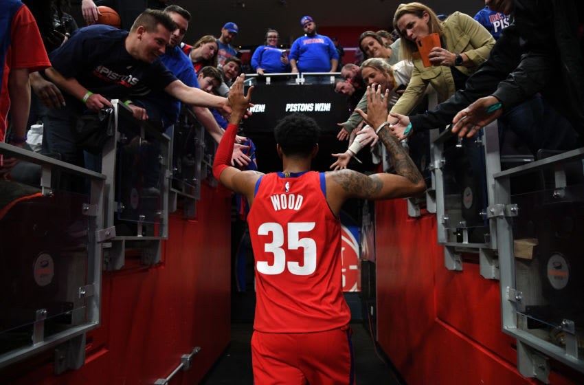 DETROIT, MI - DECEMBER 26: Christian Wood #35 of the Detroit Pistons high-fives fans after the game against the Washington Wizards on December 26, 2019 at Little Caesars Arena in Detroit, Michigan. NOTE TO USER: User expressly acknowledges and agrees that, by downloading and/or using this photograph, User is consenting to the terms and conditions of the Getty Images License Agreement. Mandatory Copyright Notice: Copyright 2019 NBAE (Photo by Chris Schwegler/NBAE via Getty Images)