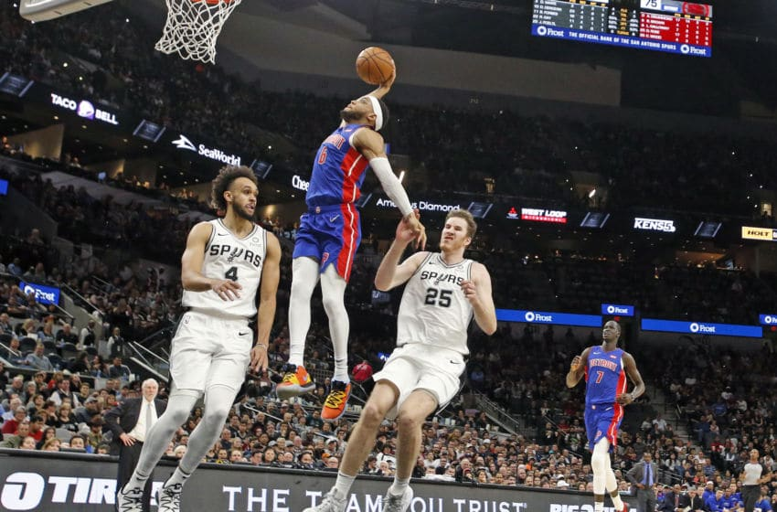 SAN ANTONIO, TX - DECEMBER 28: Bruce Brown #6 of the Detroit Pistons dunks past Derrick White #4 of the San Antonio Spurs during second half action at AT&T Center on December 28, 2019 in San Antonio, Texas. San Antonio Spurs defeated the Detroit Pistons 136-109. NOTE TO USER: User expressly acknowledges and agrees that , by downloading and or using this photograph, User is consenting to the terms and conditions of the Getty Images License Agreement. (Photo by Ronald Cortes/Getty Images)