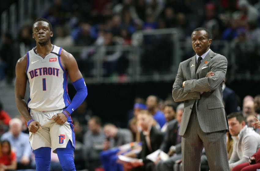 DETROIT, MI - FEBRUARY 8: Reggie Jackson #1 of the Detroit Pistons and head coach Dwane Casey of the Detroit Pistons wait for play to resume against the New York Knicks during the second half at Little Caesars Arena on February 8, 2020, in Detroit, Michigan. The Knicks defeated the Pistons 95-92. NOTE TO USER: User expressly acknowledges and agrees that, by downloading and or using this photograph, User is consenting to the terms and conditions of the Getty Images License Agreement. (Photo by Duane Burleson/Getty Images)