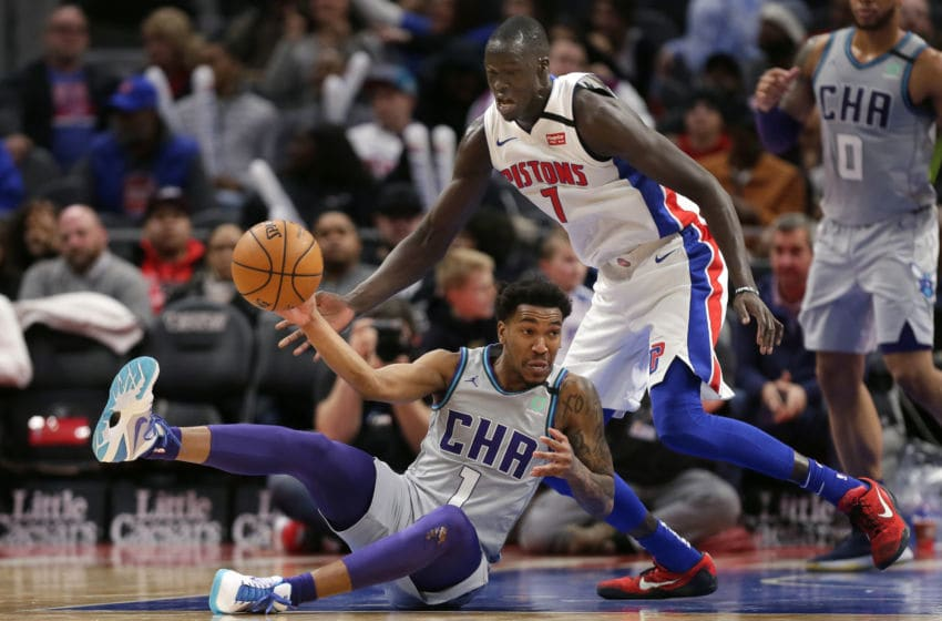 DETROIT, MI - FEBRUARY 10: Malik Monk #1 of the Charlotte Hornets passes the ball while being guarded by Thon Maker #7 of the Detroit Pistons during the second half at Little Caesars Arena on February 10, 2020, in Detroit, Michigan. The Hornets defeated the Pistons 87-76. NOTE TO USER: User expressly acknowledges and agrees that, by downloading and or using this photograph, User is consenting to the terms and conditions of the Getty Images License Agreement. (Photo by Duane Burleson/Getty Images)