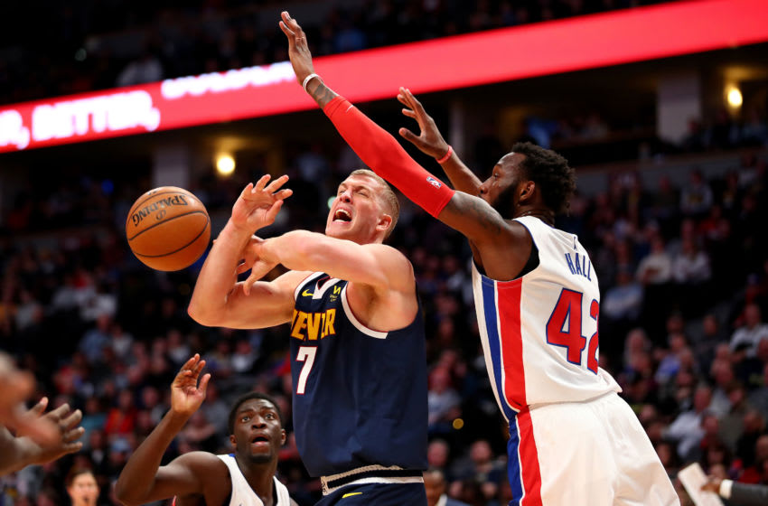 DENVER, CO - FEBRUARY 25: Donta Hall #42 of the Detroit Pistons knocks the ball away from Mason Plumlee #7 of the Denver Nuggets (Photo by Jamie Schwaberow/Getty Images)
