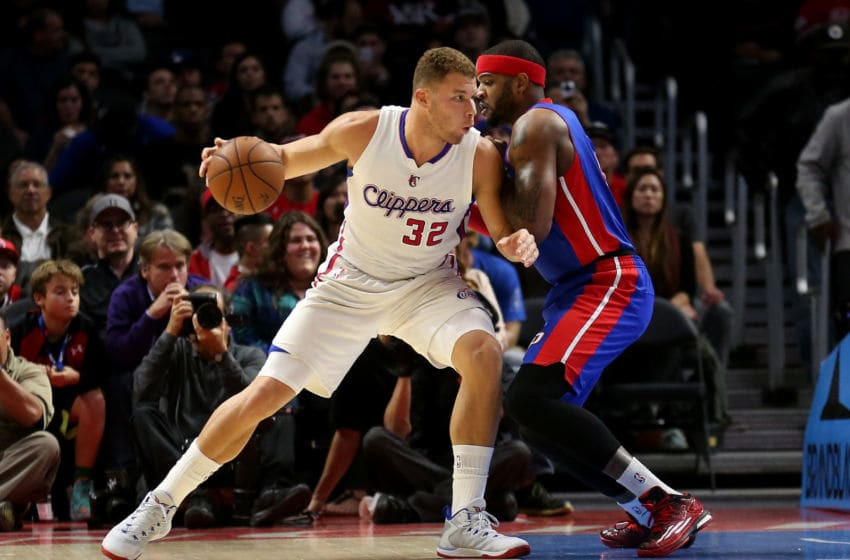 Former Detroit Pistons forward Josh Smith defends current Detroit Pistons forward Blake Griffin, then with the Los Angeles Clippers. (Photo by Stephen Dunn/Getty Images)