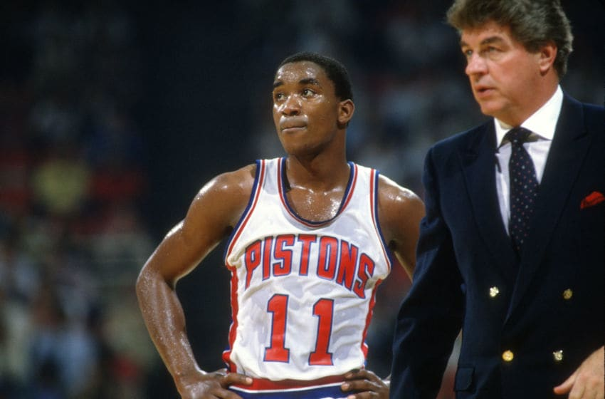 PONTIAC, MI - CIRCA 1987: Isiah Thomas #11 of the Detroit Pistons looks on with head coach Chuck Daly whiles there's a break in the action during an NBA basketball game circa 1987 at The Pontiac Silverdome in Pontiac, Michigan . Thomas played for the Pistons from 1981-94. (Photo by Focus on Sport/Getty Images)