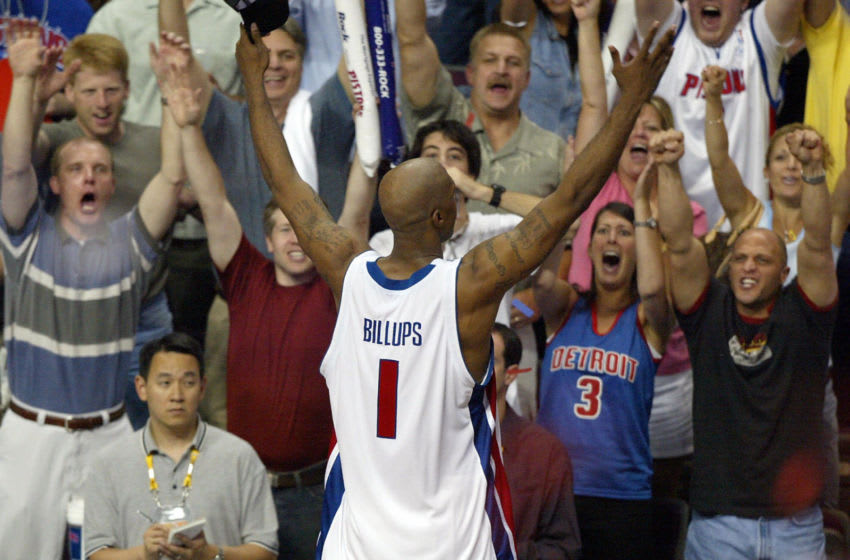 AUBURN HILLS, UNITED STATES: Chauncey Billups of the Detroit Piston celebrates with the fans after the Pistons defeated the Lakers 100-87 to win the 2004 NBA championship final, in Auburn Hills, MI, 15 June 2004. The Pistons won the best-of-seven NBA championship series 5-1 and Billups was the series MVP. AFP PHOTO / Robyn BECK (Photo credit should read ROBYN BECK/AFP via Getty Images)
