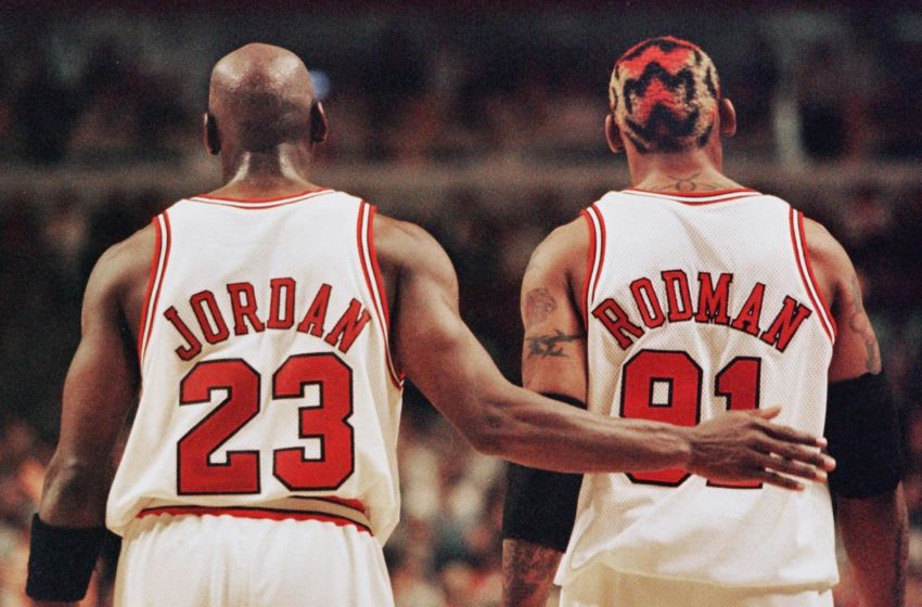 CHICAGO, UNITED STATES: Michael Jordan (L) pats Dennis Rodman (R), both of the Chicago Bulls, after Rodman was called for a technical foul 03 May during the second half of their NBA eastern conference semi-finals game against the Charlotte Hornets at the United Center in Chicago, IL. The Bulls won the game 83-70 to lead the series 1-0. AFP PHOTO/JEFF HAYNES (Photo credit should read JEFF HAYNES/AFP via Getty Images)