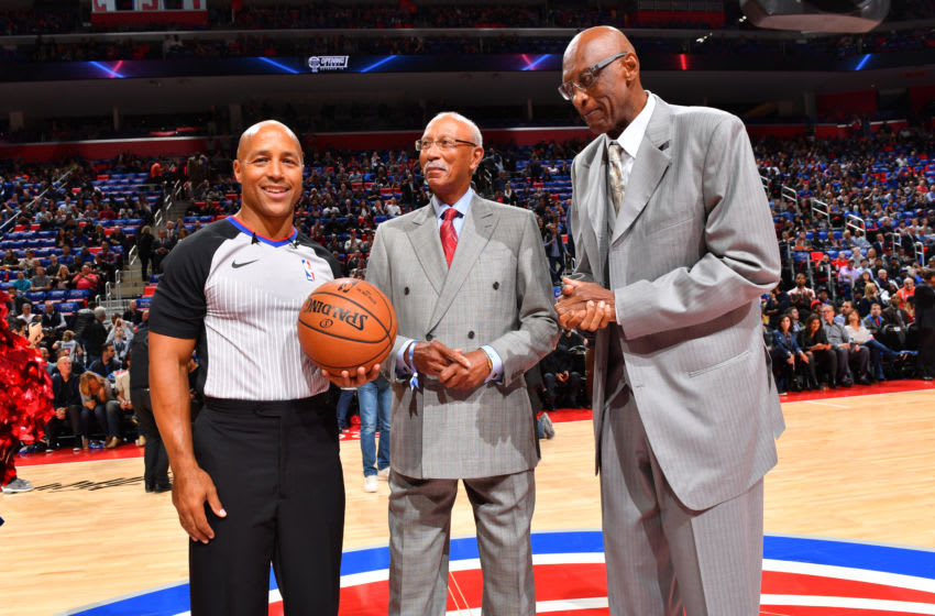 DETROIT, MI - OCTOBER 18: Referee, Marc Davis poses for a photo with Dave Bing and Bob Lanier before the game between the Charlotte Hornets and the Detroit Pistons on October 18, 2017 at Little Caesars Arena in Detroit, Michigan. NOTE TO USER: User expressly acknowledges and agrees that, by downloading and/or using this photograph, User is consenting to the terms and conditions of the Getty Images License Agreement. Mandatory Copyright Notice: Copyright 2017 NBAE (Photo by Jesse D. Garrabrant/NBAE via Getty Images)