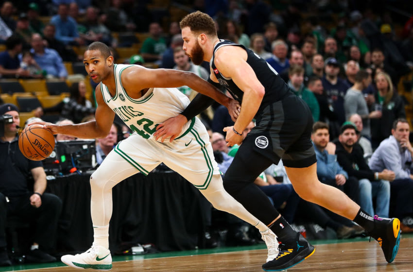 Al Horford #42 of the Boston Celtics dribbles the ball while guarded by Blake Griffin #23 of the Detroit Pistons (Photo by Adam Glanzman/Getty Images)
