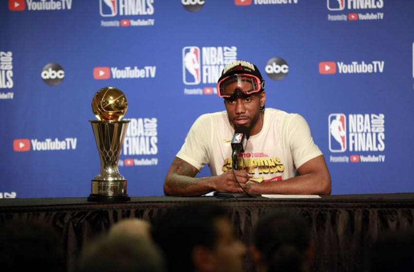 OAKLAND, CA - JUNE 13: Kawhi Leonard #2 of the Toronto Raptors talks to the media during a press conference with the Larry O'Brien Trophy after Game Six of the NBA Finals against the Golden State Warriors in Game Six of the NBA Finals on June 13, 2019 at Oracle Arena in Oakland, California. NOTE TO USER: User expressly acknowledges and agrees that, by downloading and/or using this photograph, user is consenting to the terms and conditions of the Getty Images License Agreement. Mandatory Copyright Notice: Copyright 2019 NBAE (Photo by Jack Arent/NBAE via Getty Images)