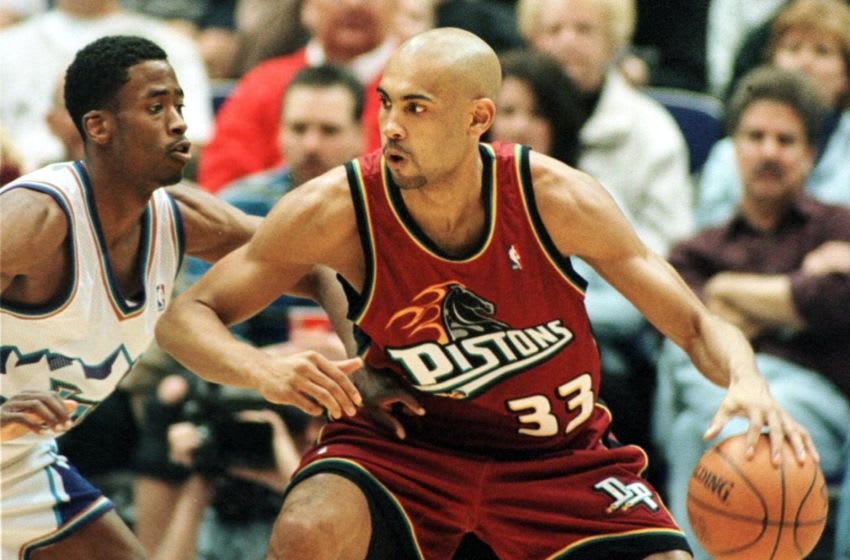 Grant Hill (R) of the Detroit Pistons (Photo by GEORGE FREY/AFP via Getty Images)