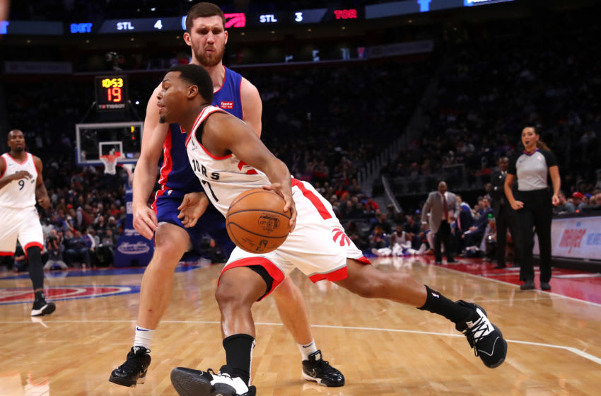 Kyle Lowry #7 of the Toronto Raptors tires to drive around Sviatoslav Mykhailiuk #19 of the Detroit Pistons (Photo by Gregory Shamus/Getty Images)