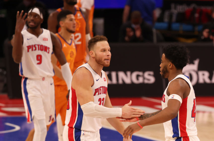 Blake Griffin #23 and Saddiq Bey #41 of the Detroit Pistons (Photo by Leon Halip/Getty Images)