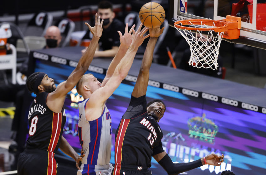 MIAMI, FLORIDA - JANUARY 18: Maurice Harkless #8 and Bam Adebayo #13 of the Miami Heat fight for a rebound against Mason Plumlee #24 of the Detroit Pistons during the third quarter at American Airlines Arena on January 18, 2021 in Miami, Florida. NOTE TO USER: User expressly acknowledges and agrees that, by downloading and or using this photograph, User is consenting to the terms and conditions of the Getty Images License Agreement. (Photo by Michael Reaves/Getty Images)