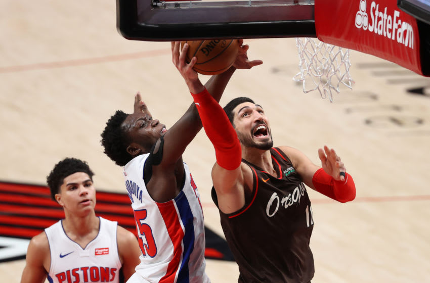 Enes Kanter #11 of the Portland Trail Blazers takes a shot against Sekou Doumbouya #45 of the Detroit Pistons (Photo by Abbie Parr/Getty Images)