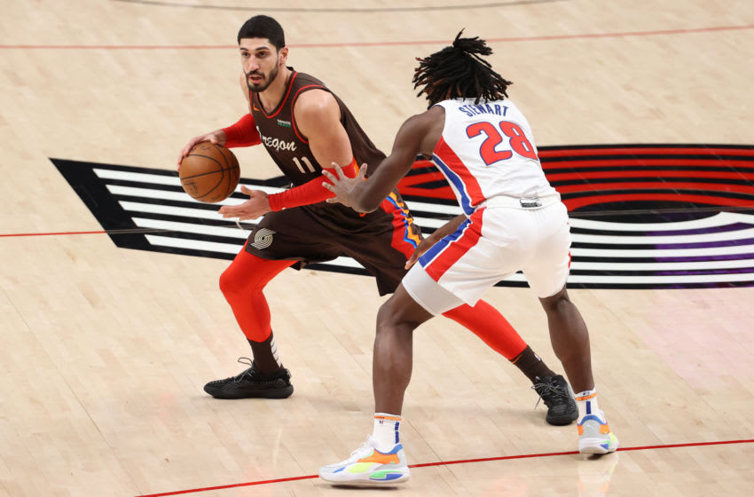 PORTLAND, OREGON - APRIL 10: Enes Kanter #11 of the Portland Trail Blazers handles the ball against Isaiah Stewart #28 of the Detroit Pistons in the third quarter at Moda Center on April 10, 2021 in Portland, Oregon. NOTE TO USER: User expressly acknowledges and agrees that, by downloading and or using this photograph, User is consenting to the terms and conditions of the Getty Images License Agreement. (Photo by Abbie Parr/Getty Images)