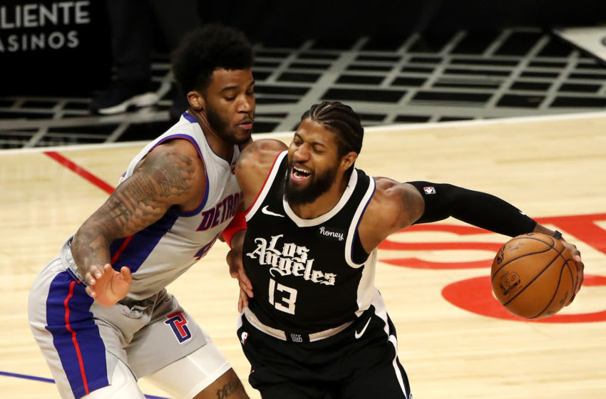 Paul George #13 of the Los Angeles Clippers drives to the basket against Saddiq Bey #41 of the Detroit Pistons (Photo by Katelyn Mulcahy/Getty Images)