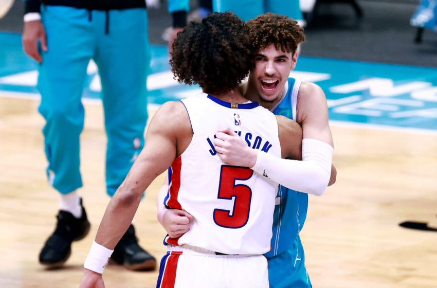 CHARLOTTE, NORTH CAROLINA - MAY 01: LaMelo Ball #2 of the Charlotte Hornets embraces Frank Jackson #5 of the Detroit Pistons (Photo by Grant Halverson/Getty Images)
