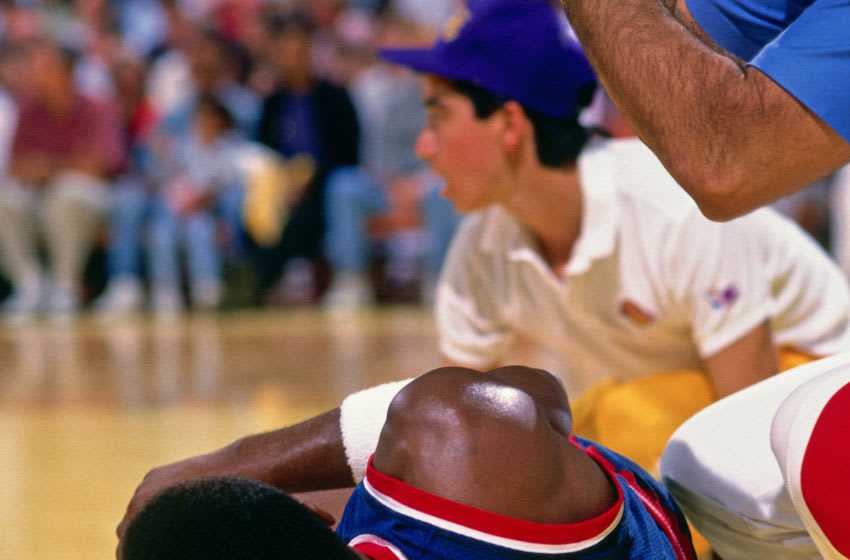 INGLEWOOD, CA - JUNE 19: Isiah Thomas #11 of the Detroit Pistons injures his ankel against the Los Angeles Lakers during Game Six of the 1988 WNBA Finals on June 19, 1988 at the Great Western Forum in Inglewood, California. NOTE TO USER: User expressly acknowledges and agrees that, by downloading and or using this photograph, User is consenting to the terms and conditions of the Getty Images License Agreement. Mandatory Copyright Notice: Copyright 1988 NBAE (Photo by Andrew D. Bernstein/NBAE via Getty Images)