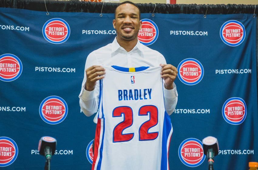 AUBURN HILLS, MI - JULY 13: Stan Van Gundy, president of basketball operations of the Detroit Pistons present Avery Bradley his jersey during a press conference on July 13, 2017 at the Detroit Pistons Practice Facility in Auburn Hills, Michigan. NOTE TO USER: User expressly acknowledges and agrees that, by downloading and or using this photograph, User is consenting to the terms and conditions of the Getty Images License Agreement. Mandatory Copyright Notice: Copyright 2017 NBAE (Photo by Chris Schwegler/NBAE via Getty Images)