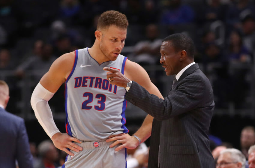 DETROIT, MICHIGAN - NOVEMBER 25: Head coach Dwane Casey of the Detroit Pistons talks to Blake Griffin (Photo by Gregory Shamus/Getty Images)