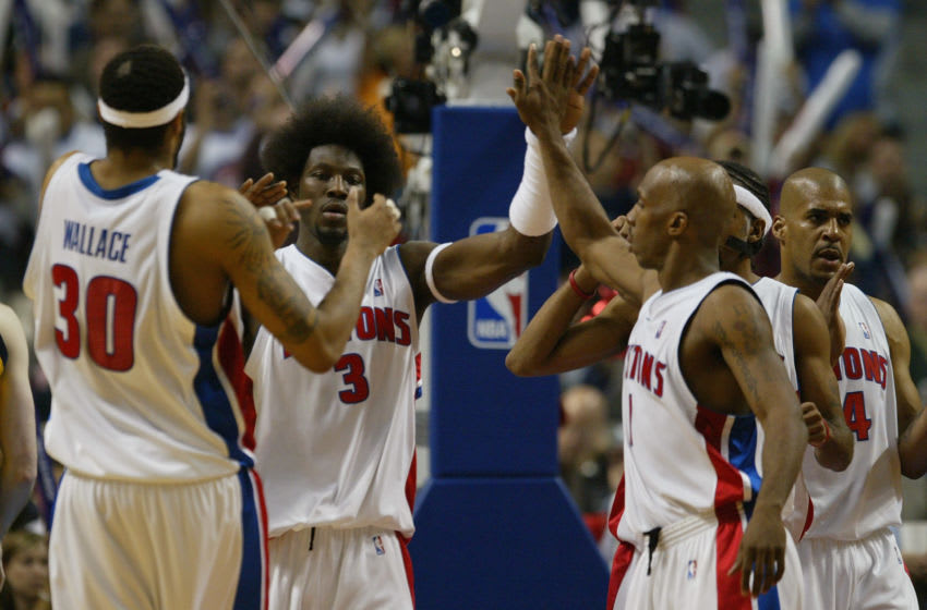 AUBURN HILLS, MI - JUNE 1: Ben Wallace #3 of the Detroit Pistons celebrates with his teammates Rasheed Wallace #30 and Chauncey Billups #1 in Game six of the Eastern Conference Finals against the Indiana Pacers during the 2004 NBA Playoffs at The Palace of Auburn Hills on June 1, 2004 in Auburn Hills, Michigan. The Pistons won 69-65 and won the series 4-2. NOTE TO USER: User expressly acknowledges and agrees that, by downloading and/or using this Photograph, user is consenting to the terms and conditions of the Getty Images License Agreement. (Photo by Ezra Shaw/Getty Images)