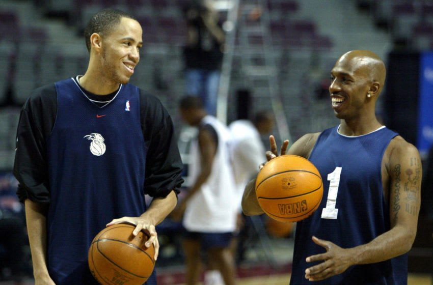 AUBURN HILLS, UNITED STATES: Tayshaun Prince (L) and Chauncey Billups (R) of the Detroit Pistons joke around during practice for the NBA Finals against the Los Angeles Lakers 11 June, 2004, at The Palace in Auburn Hills, MI. The Pistons lead in the best-of-seven game series two games to one. AFP PHOTO/Jeff HAYNES (Photo credit should read JEFF HAYNES/AFP via Getty Images)