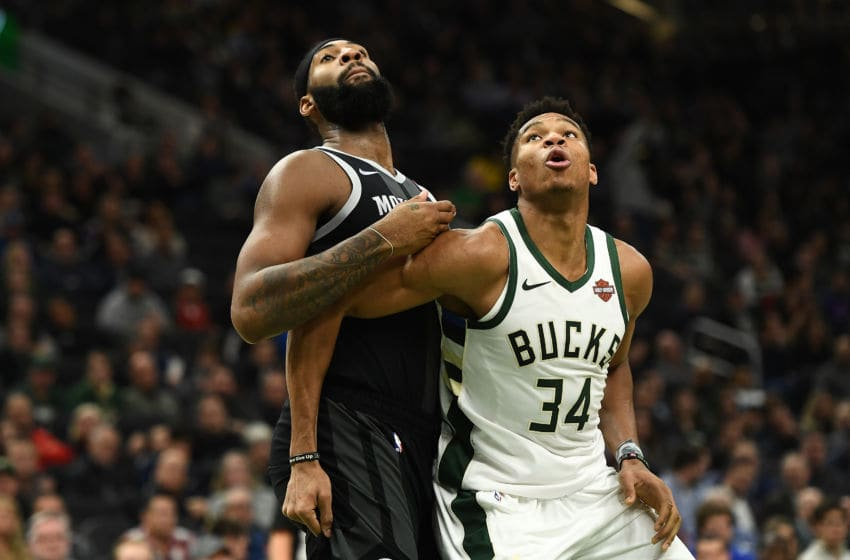 MILWAUKEE, WISCONSIN - DECEMBER 05: Andre Drummond #0 of the Detroit Pistons and Giannis Antetokounmpo #34 of the Milwaukee Bucks work for a rebound during a game at Fiserv Forum on December 05, 2018 in Milwaukee, Wisconsin. NOTE TO USER: User expressly acknowledges and agrees that, by downloading and or using this photograph, User is consenting to the terms and conditions of the Getty Images License Agreement. (Photo by Stacy Revere/Getty Images)